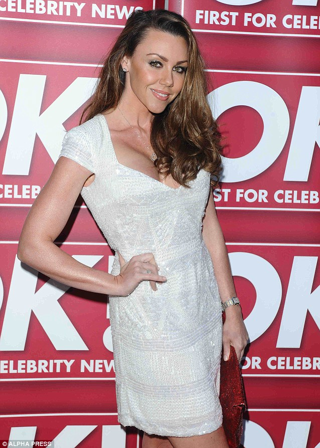 Shimmering: Michelle wore a beaded white dress to the OK! Magazine 20th Anniversary Photographic Exhibition
