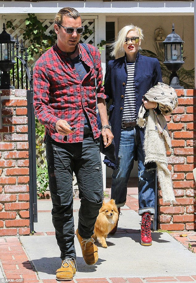 Dog lovers: Rock star couple Gwen Stefani and Gavin Rossdale took their pet Pomeranian Chewy on a sunny stroll through Van Nuys Tuesday