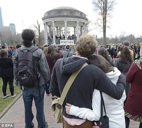 People gather for a vigil for the victims on the Boston Common as an investigation continues into dual bombings at the Boston Marathon finish line in Boston, Massachusetts, on Tuesday