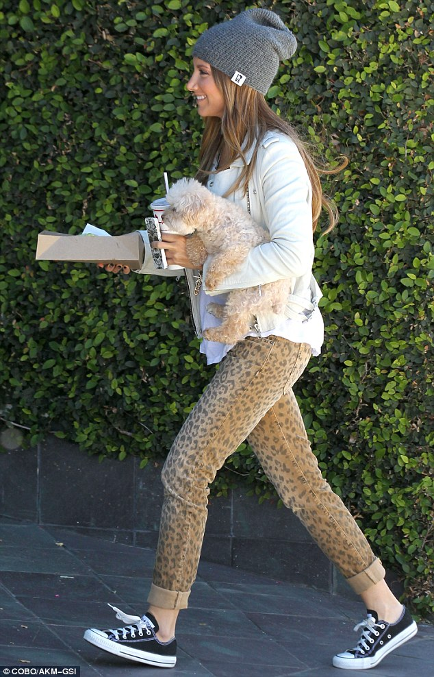 Taking a walk on the wild side: Ashley was dressed cute and casual for the outing, parading her slim pins in some animal print jeans