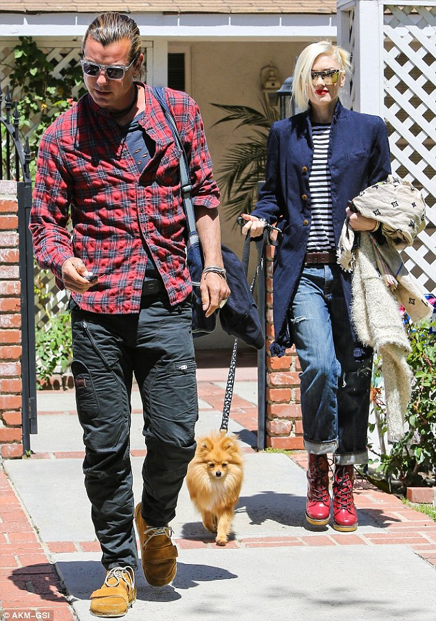 Attractive couple: With her platinum blonde hair twisted into a messy updo, the three-time Grammy winner clutched a Louis Vuitton scarf, a fuzzy white jacket, and Chewy's leash