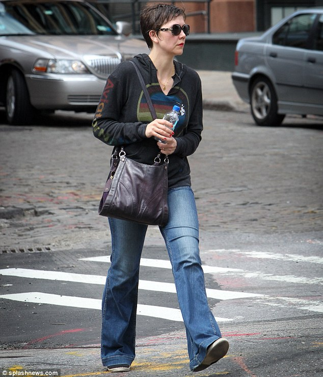 Dressed down: The mother-of-two sported red nail polish as she carried a Fiji water bottle