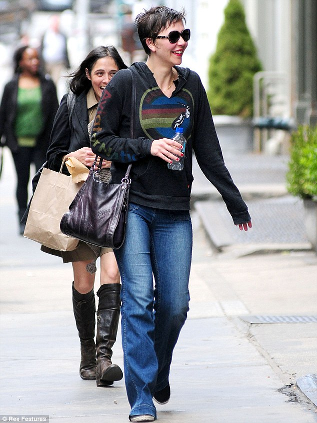 A trip back in time: The actress wore denim bell bottoms and a hooded jumper, embodying 1970s casual during the day