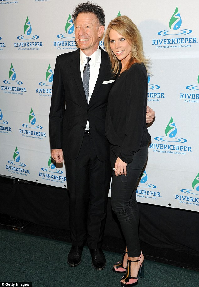 Love it! Lyle Lovett and Cheryl brandished big grins as they posed for snaps