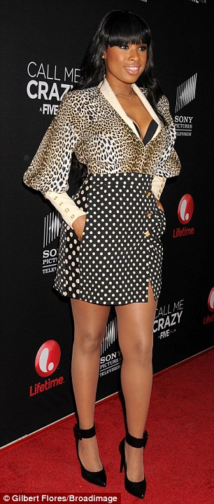 Amply charmed: The 31-year-old Oscar winner flashed a bit of her black bra under a leopard-print blouse tucked into a polka-dot mini-skirt