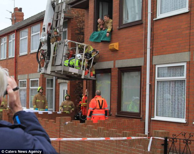 Fire crews arrived to manoeuvre the crane into place and Mrs Smith, from Hull, was carried out of the window on to the platform before being lowered to the ground