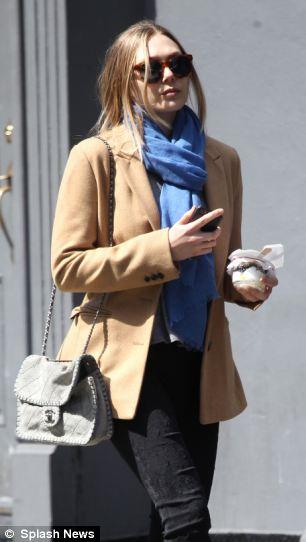 Elizabeth Olsen wanders through Soho
