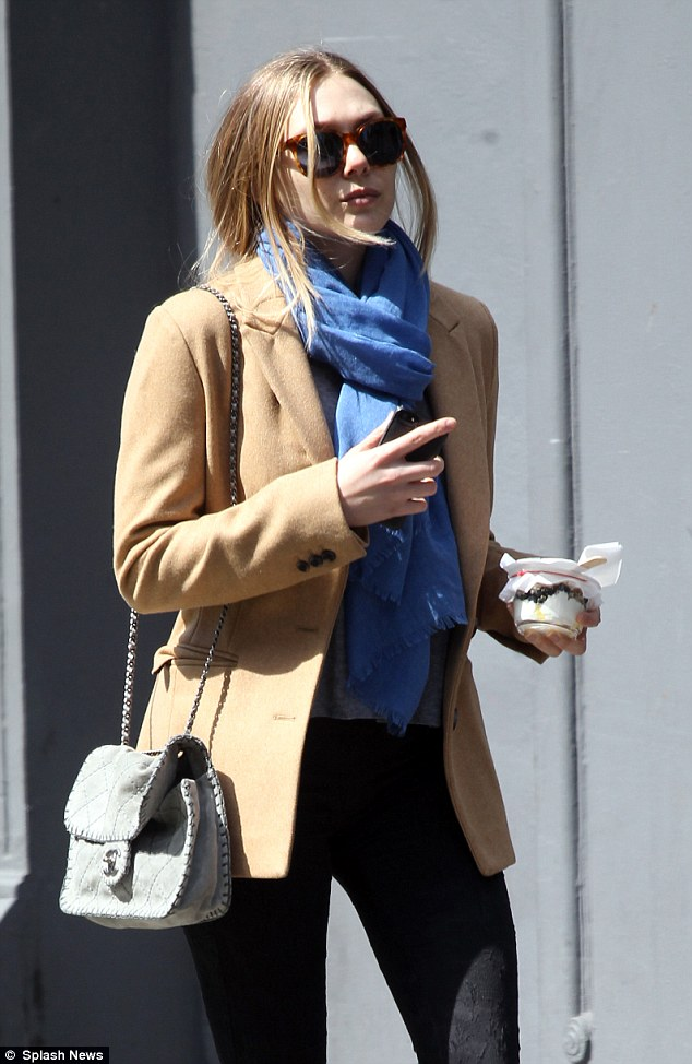 Off-duty style: Elizabeth opted for comfortable jeans and boots to wander through Soho the day before the charity event