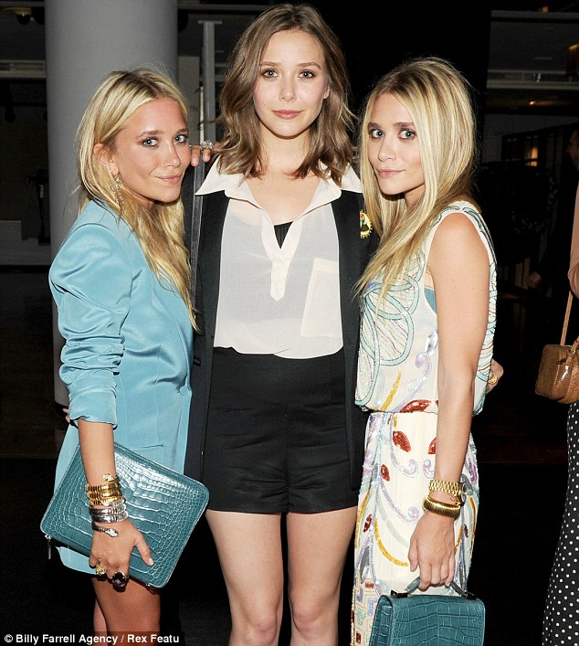 Elizabeth admits she takes style tips from big sisters, designers Mary-Kate and Ashley