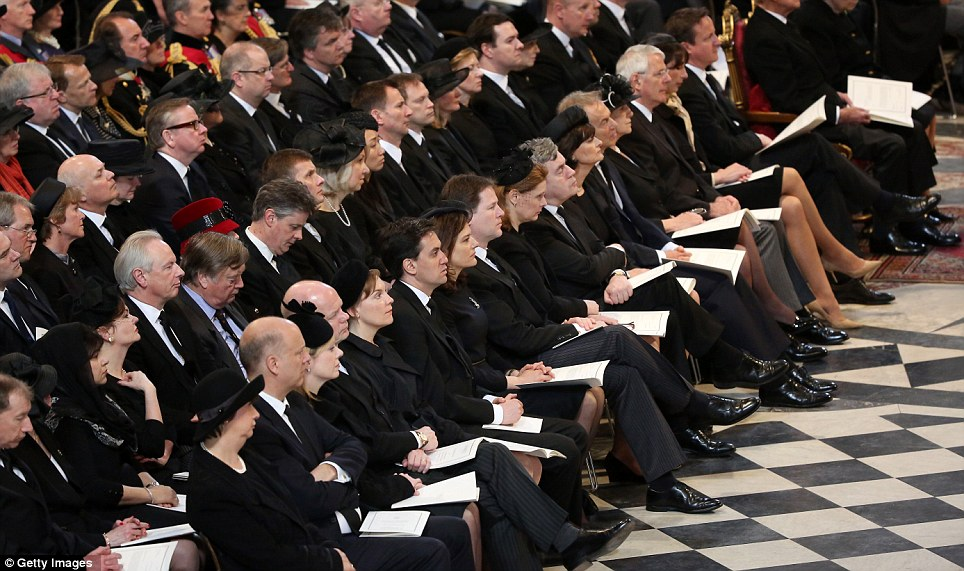 The British politicians and their wives sit in the front row of the congregation at the cathedral for the funeral of Baroness Thatcher this morning