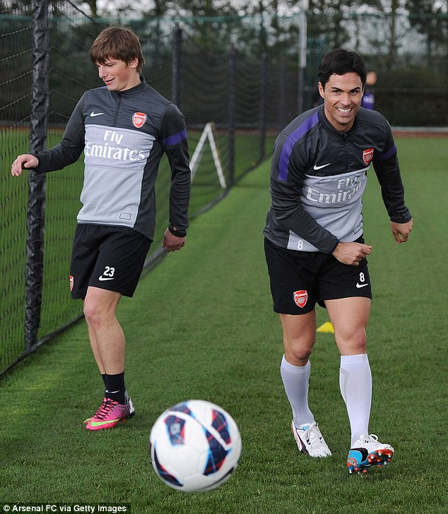 Happier times: Arshavin in training with Mikel Arteta recently
