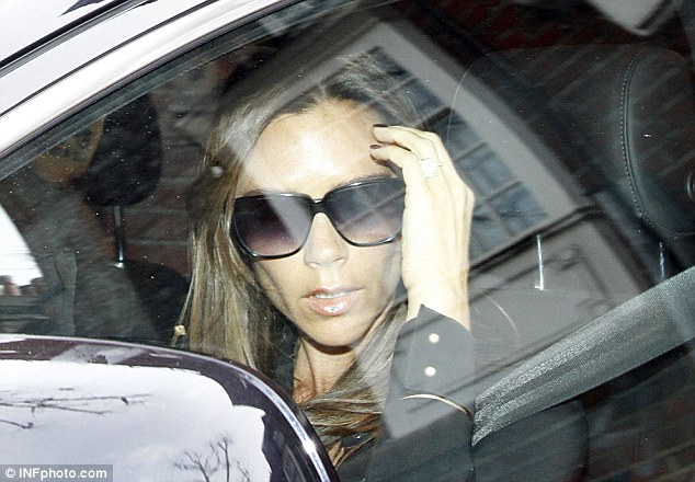 She doesn't do birthdays: Victoria looks less than impressed on her 39th birthday - but to be fair that's not unusual