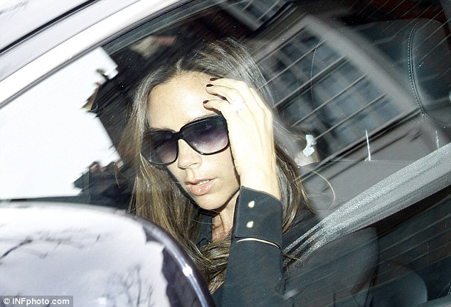 Party girl: Victoria saved her smiles for inside her birthday bash - as she left her 39th with her trademark pout