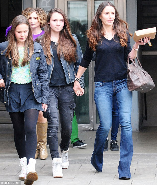 Looking good! Tana Ramsay leaves the restaurant with her two daughters, she obviously liked the food as she left carrying a doggy bag