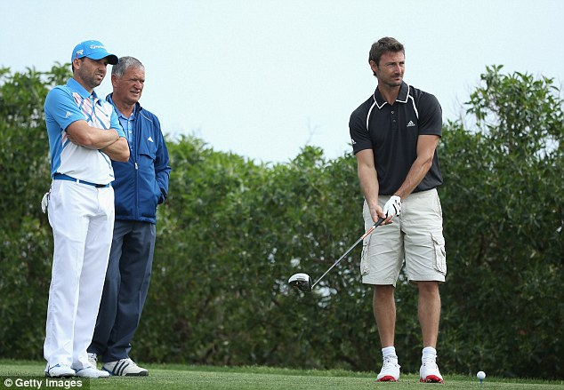 Different ball game: Garcia and his dad Victor watch former tennis ace Juan Carlos Ferrero during the pro-am