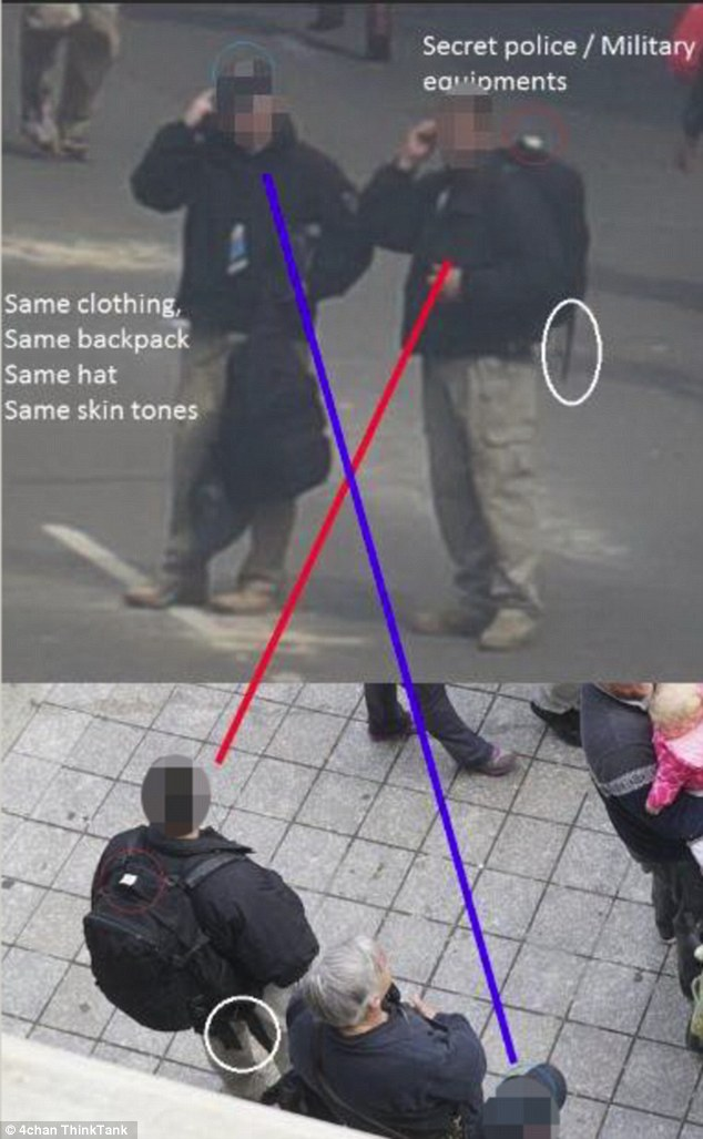 Another look: Two men donning similar black coats, khaki pants and backpacks were also pictured, but they could also be undercover police officers