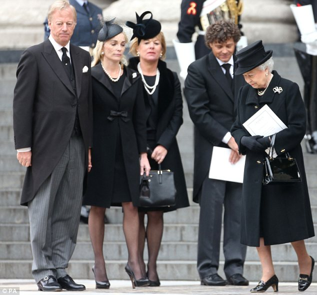 Family: Thatcher relatives including Mark and Carol, pictured with the Queen, attended the cremation