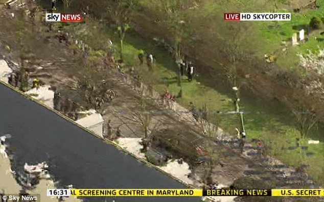 Arrival: The convoy as it reached Mortlake in South-West London for the cremation