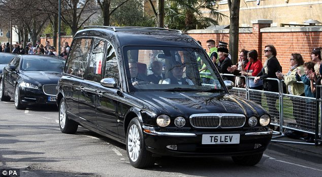 Crowd: Well-wishers lined the route and applauded the arrival of the convoy in Mortlake