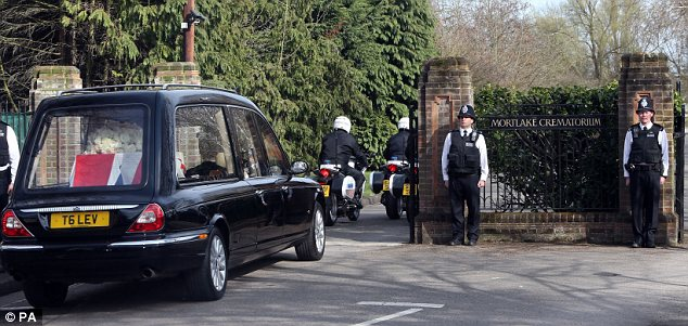Final journey: Baroness Thatcher's coffin enters Mortlake Crematorium in South-West London this afternoon
