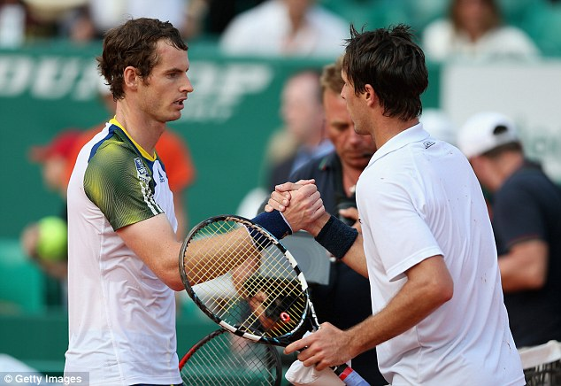Outclassed: Murray shakes hands with Roger-Vasselin after a thumping win