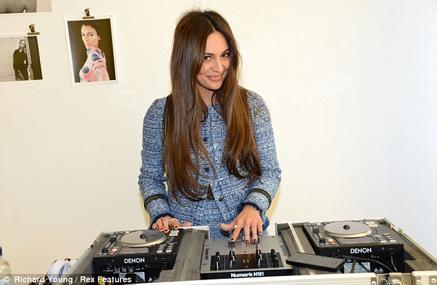Spin that tune: The model took to the decks at the event showing off her musical skills