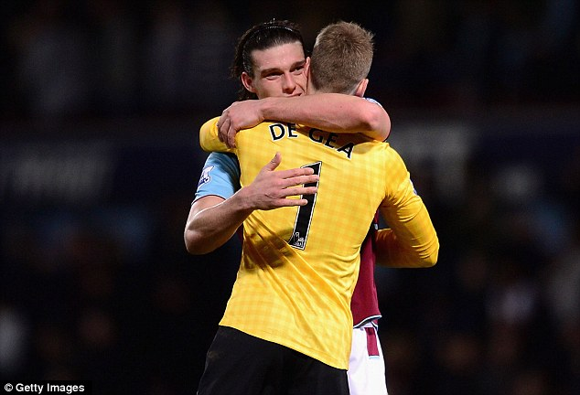 Friends again: Carrol gives De Gea a hug at the final whistle