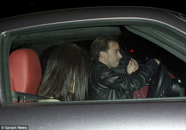 A new love interest? The 26-year-old was seen sitting next to a man wearing a black leather jacket and thick blonde hair