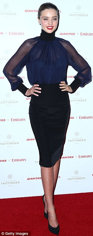 Who needs Victoria's Secret: Miranda shrugged off the speculation about her behaviour to put on a smile