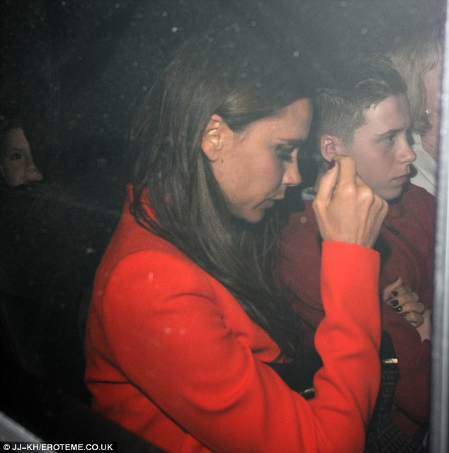Dinner date: The 13-year-old stepped up to being the man of the house with David away in Paris, and Victoria was seen linking her eldest son's arm as they left the eatery