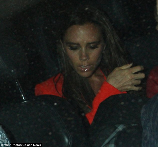 Birthday pampering: Victoria wore a vibrant red jacket to dinner and appeared to have added extra eyelash extensions to celebrate her birthday
