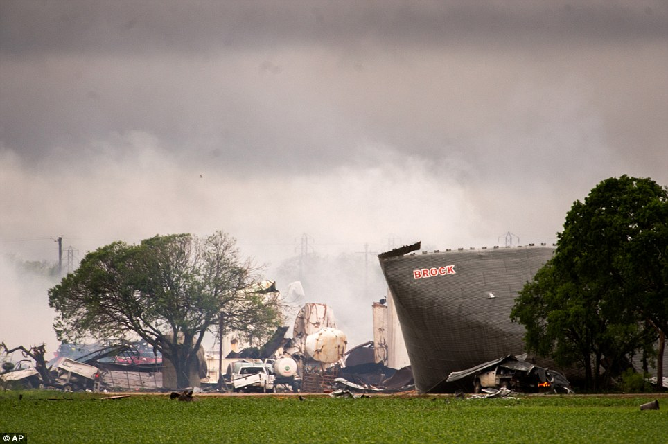 Aftermath: The remains of the the West Fertilizer Co. plant smolder in the rain on Thursday after a massive explosion on Wednesday night