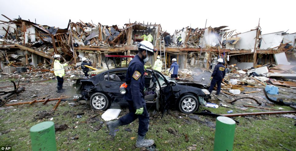 Devastation: Firefighters conduct search and rescue of an apartment destroyed by an explosion at a fertilizer plant in West, Texas, which has killed 15