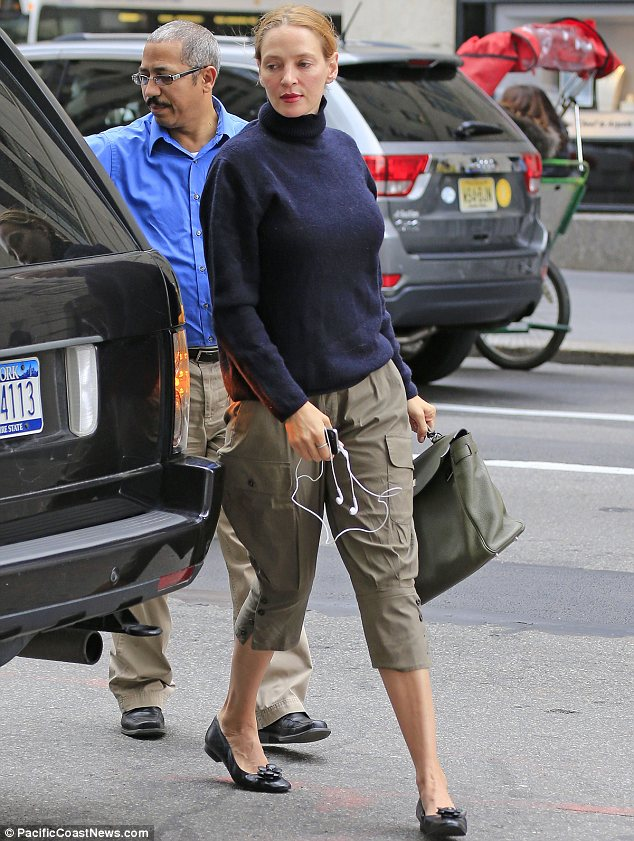 Misfiring: It was a vast improvement on the day before, when Uma had sported a frumpy outfit to shop at Louis Vuitton
