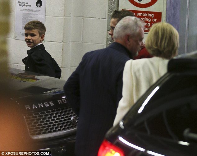 Smiley: Romeo looked excited about the family celebration as he walked in front of his brother and grandparents