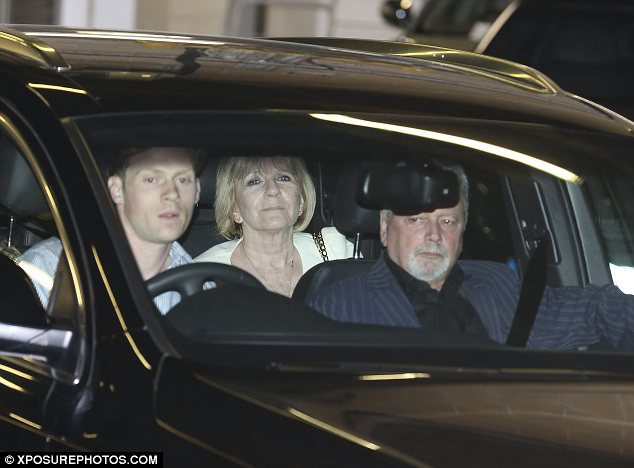 All together now: Victoria's mother sat in the back seat next to Brooklyn while her father sat in the front of the car