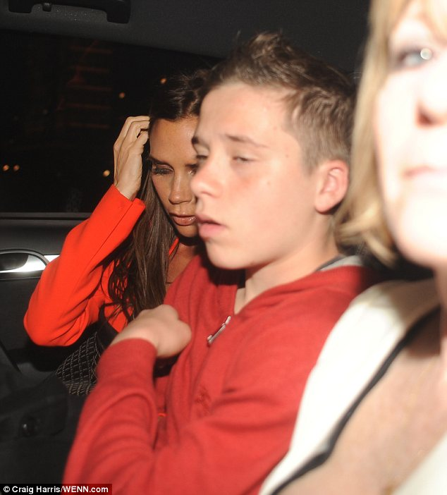 Worn out: Victoria and her son Brooklyn looked shattered as they left the meal