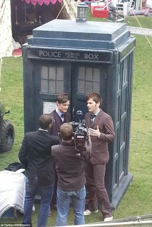 Double trouble: In a Twitter snap the pair are seen being interviewed by a reporter in front of the Tardis