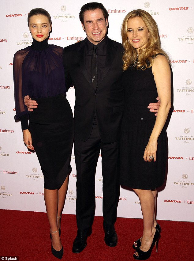Chic: Miranda joins John and his wife Kelly Preston on the red carpet