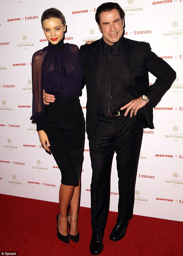 Friend in high places: Miranda cosies up to Hollywood star John Travolta