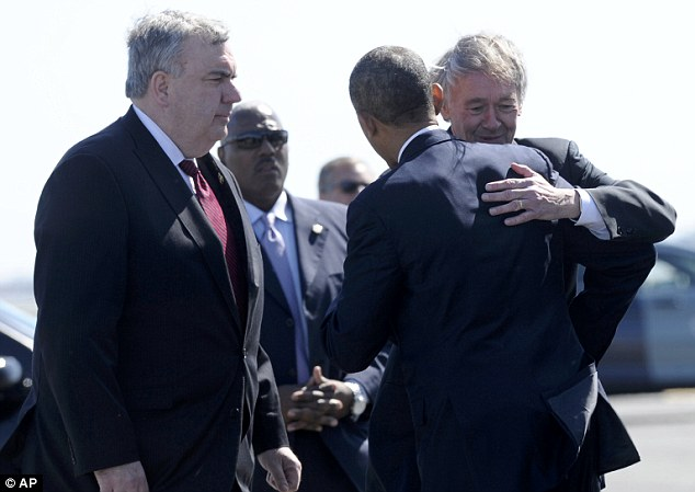 Support: President Barack Obama hugs Rep. Edward Markey, D-Mass., and greets Boston Police Commissioner Edward Davis, left, after arriving at Boston's Logan International Airport, Thursday, April 18, 2013