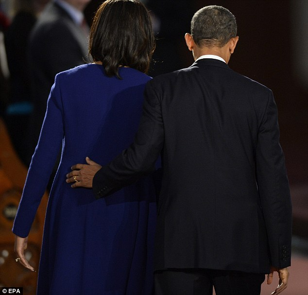 Comfort: US President Barack Obama and First Lady Michelle Obama leave at the conclusion of an interfaith service