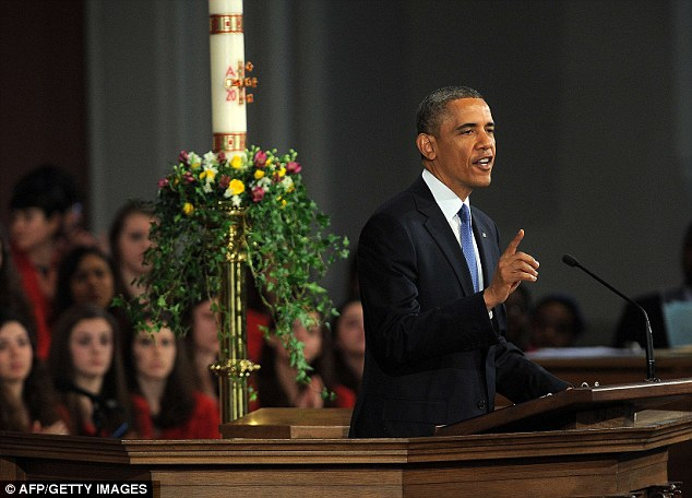 Race again: President Barack Obama addresses the audience during an interfaith service held at the Cathedral of the Holy Cross in Boston, Massachusetts, insisting 'we will race again'
