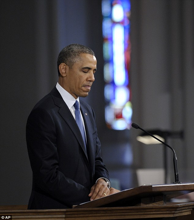 Sadness: President Barack Obama pauses while speaking at the 'Healing Our City: An Interfaith Service' at the Cathedral of the Holy Cross in Boston
