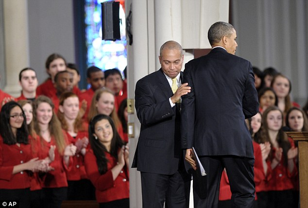 Emotion: Massachusetts Gov. Deval Patrick hugs President Barack Obama as Obama was introduced to speak