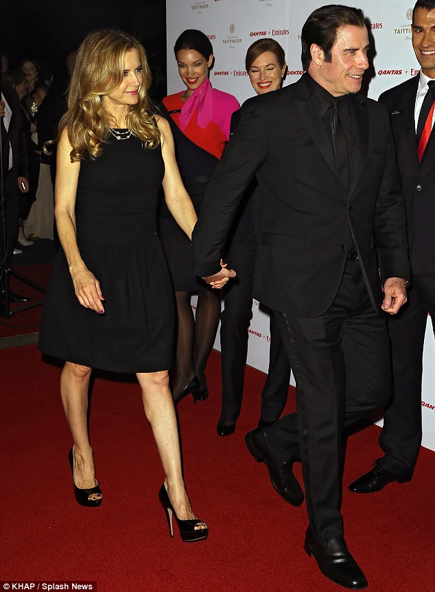Nimble on his feet: Slim JOhn skipped through the red carpet with his wife Kelly Preston