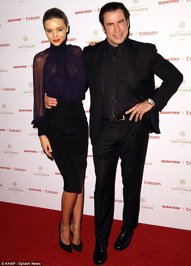 Staying a-lithe! Newly slim John Travolta held his own next to svelte model Miranda Kerr at a Quantas gala in Sydney on Wednesday night