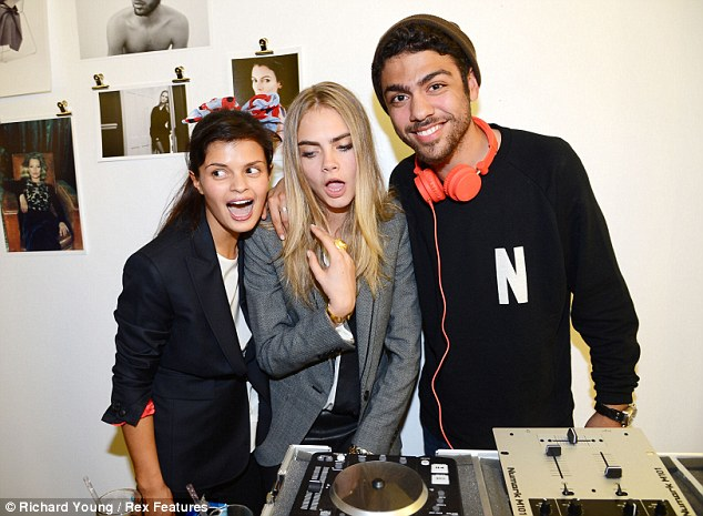 Always showing off: The model pulled her typical silly faces as she posed with the DJ and a girl pal