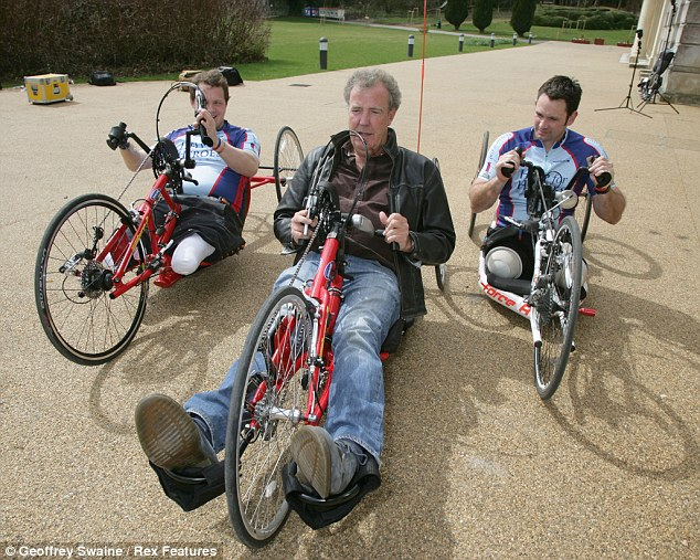 How it's done: Jeremy was shown the ropes by Staff Sergeant Steve Arnold and Corporal Josh Boggi as tried his hand at the cycling