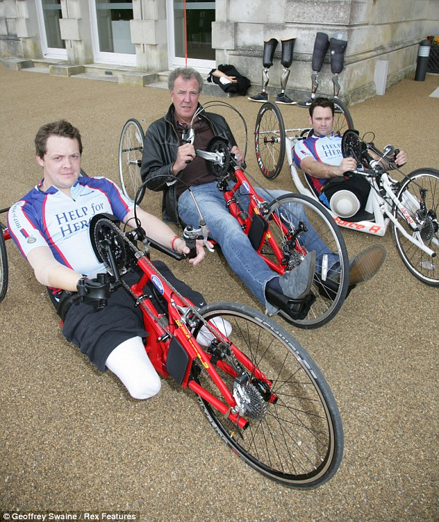 Ditched the car: Jeremy may have looked out of place behind the wheels of a bike, but it was all for charity